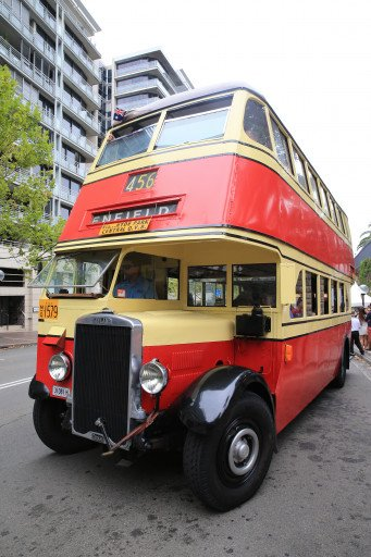 A vintage bus from the late 1940s swings around the city on Australia Day