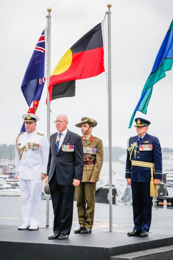His Excellency Governor of NSW David Hurley with others aboard HMAS Canberra