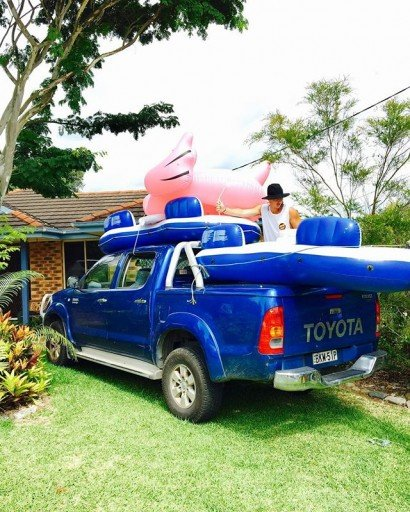 Piling a ute with inflatable pool toys by Dana Brown