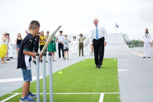 His Excellency General The Honourable David Hurley AC DSC Retd Governor of NSW plays backyard cricket on board the HMAS Canberra on Australia Day 2018