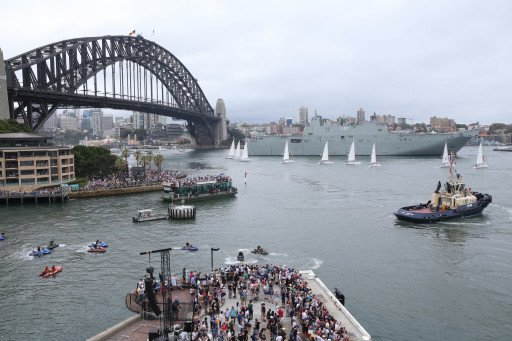 Yachts in front of HMAS Canberra and the Sydney Harbour Bridge on Australia Day 2018